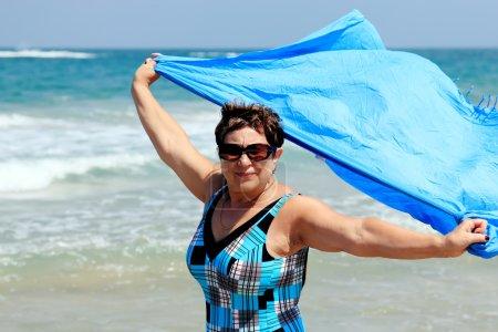 Active senior woman on the beach