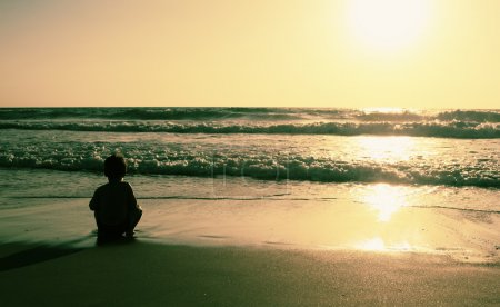Photo for Kids on the beach at sunset - Royalty Free Image