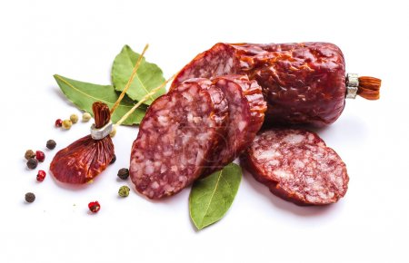 Photo for Sliced sausage with spices isolated on white background - Royalty Free Image