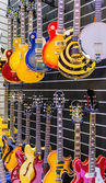 Many guitars presented in a music store