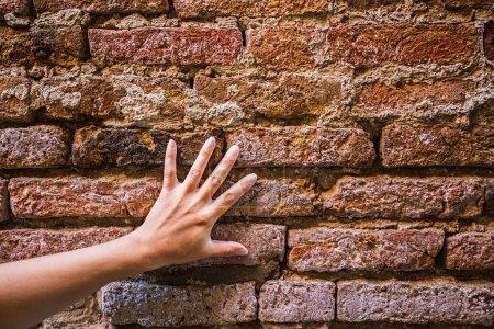 Hand touching wall