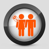 Vector illustration of a gray and orange icon depicting couple