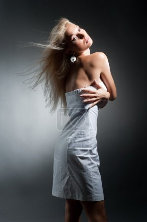 Photo for Beautiful sexual blond girl in white dress poses on grey background - Royalty Free Image