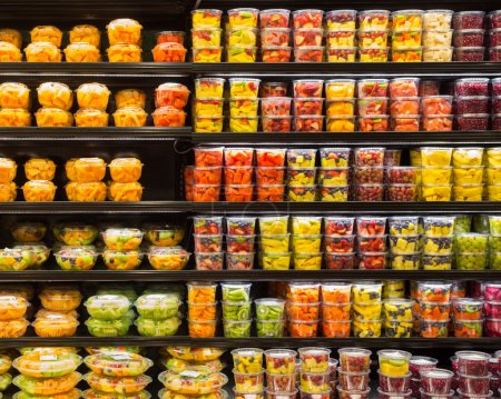 Photo for Assortment of cut fruit in containers on display for sale - Royalty Free Image