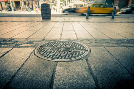 Manhole drain cover on streets of lower Manhattan...