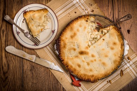 Photo for Homestyle chicken pot pie being served in rustic setting - Royalty Free Image