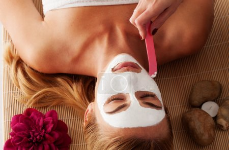 Beautiful woman having a face mask
