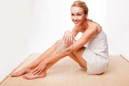 Beautiful woman relaxing in a towel