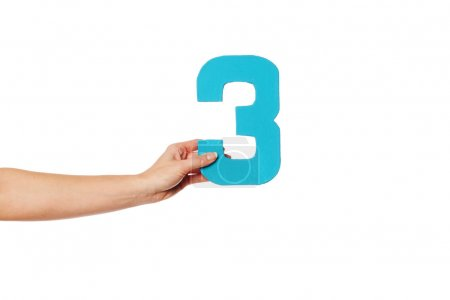Photo for Female hand holding up the number 3 against a white background conceptual of numbers, measurement, amount, quantity, accounting and mathematics - Royalty Free Image