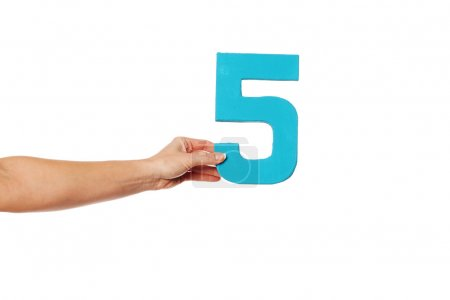 hand holding up the number five from the left
