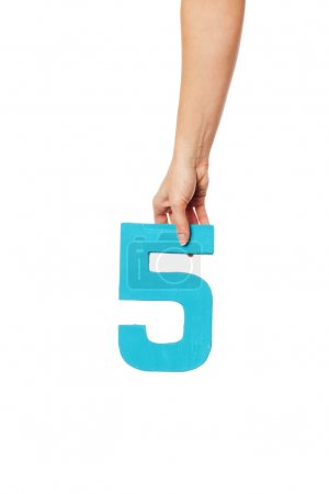 Photo for Female hand holding up the number 5 against a white background conceptual of numbers, measurement, amount, quantity, accounting and mathematics - Royalty Free Image