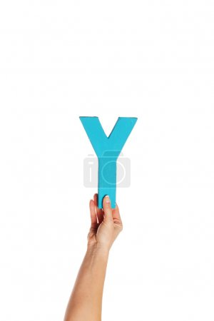 Photo for Female hand holding up the uppercase capital letter Y isolated against a white background conceptual of the alphabet, writing, literature and typeface - Royalty Free Image