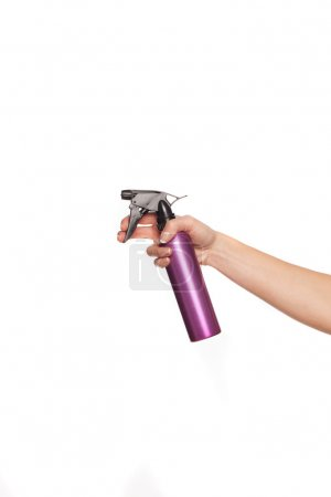Female hand holding a spray can