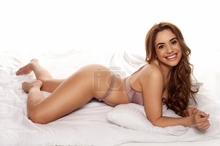 Smiling young curvy woman in lingerie