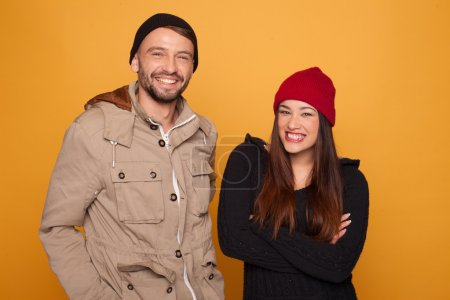 Trendy young couple with winter clothing