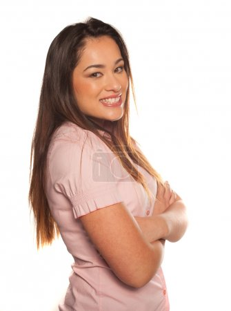 Happy young woman with crossed arms