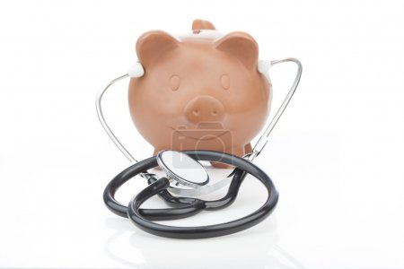 Piggy bank wearing a stethoscope