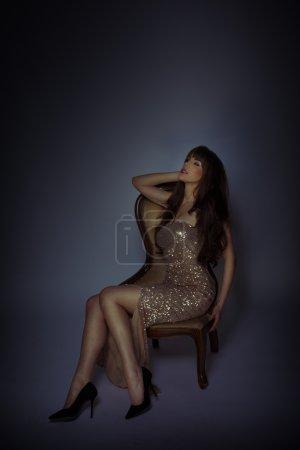 Dark atmospheric portrait of an elegant woman