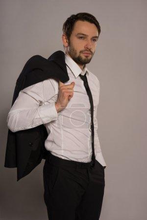 Handsome businessman loosening his tie