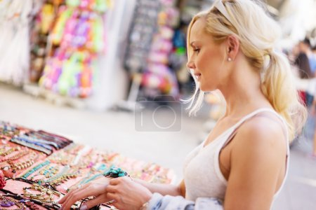 cute blonde woman on holiday buying gifts