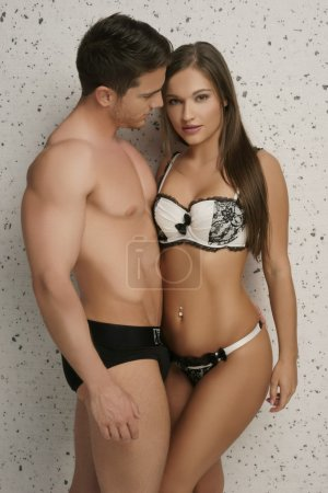Photo for Perfect Body Young Couple Wearing Sexy Underwear Only, Isolated on Dotted White - Royalty Free Image