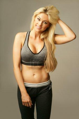 Beautiful blond woman in sexy sportswear