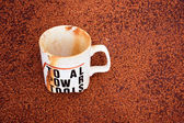 Stained Single White Cup Buried