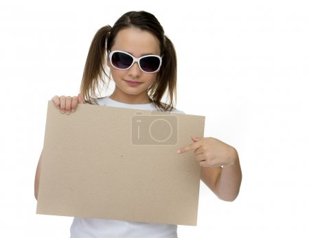 Trendy young girl pointing to a blank card