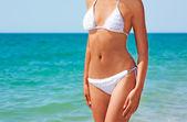 Body of Woman in Bikini at the Sea