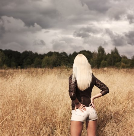 Photo for Sexy Blonde Woman Standing at the Field - Royalty Free Image