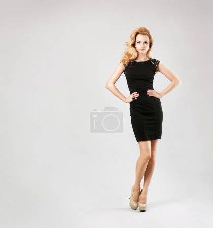 Photo for Full Length Portrait of a Sexy Blonde Woman in Little Black Fashion Dress - Royalty Free Image