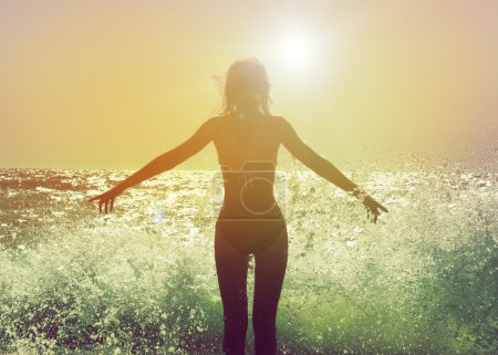 Photo for Beautiful Woman in Bikini Standing in the Sea Waves and Enjoying Sunshine with Open Arms - Royalty Free Image