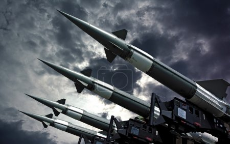Photo for Antiaircraft rockets on the launcher against dramatic sky. - Royalty Free Image