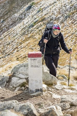 Active women on mountain path - Tatras Mountains.