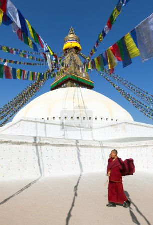 Nepal, Kathmandu -17th of December 2013: Tibetan Buddhist monks walking around Boudhanath stupa during festival