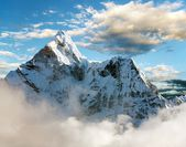 Beautiful view of Ama Dablam with and beautiful clouds - Sagarmatha national park - Khumbu valley - Trek to Everest base cam - Nepal