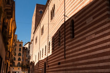Photo for Verona, northern Italy, Ancient Street, the perspective of university brick wall, arch, Piazza della Signoria, gothic architecture, transparent shadow on the wall - Royalty Free Image