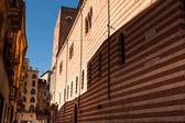 Verona, northern Italy, Ancient Street, the perspective of university brick wall, arch, Piazza della Signoria, gothic architecture