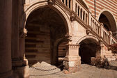 Verona, northern Italy, Ancient Street, the perspective of university walls and arch
