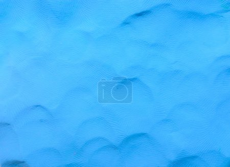 Colorful blue plasticine clay background