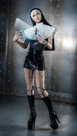 Cyber nun with electronic Holy Bible...