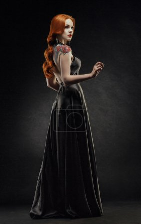 Posh redhead woman in black dress...