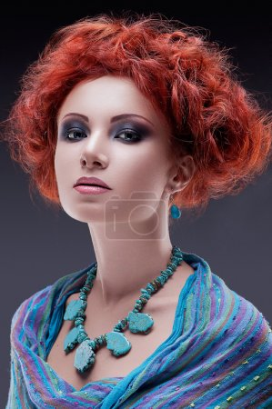 Redhead woman with turquoise necklace