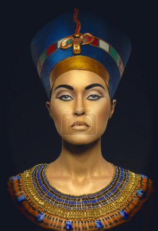 Portrait of woman with golden skin in Egyptian sty...