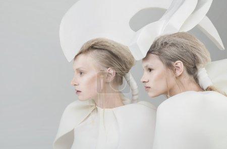 Two futuristic blonde women