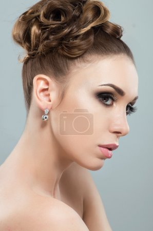 Beautiful woman with evening makeup and hairstyle