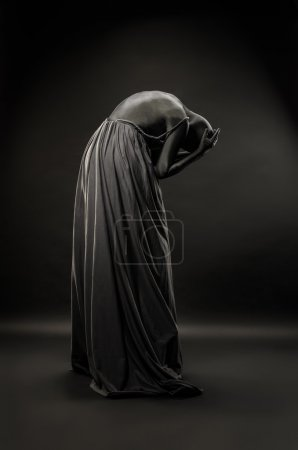 Photo for Woman wrapped in black robes - Royalty Free Image