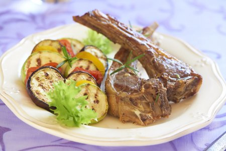 Fried lamb with vegetable garnish