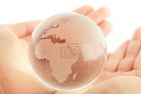 Photo for Hand holding globe to protect the fragile environment - Royalty Free Image