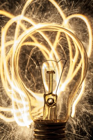 Photo for Bulb and sparklers on black background - Royalty Free Image